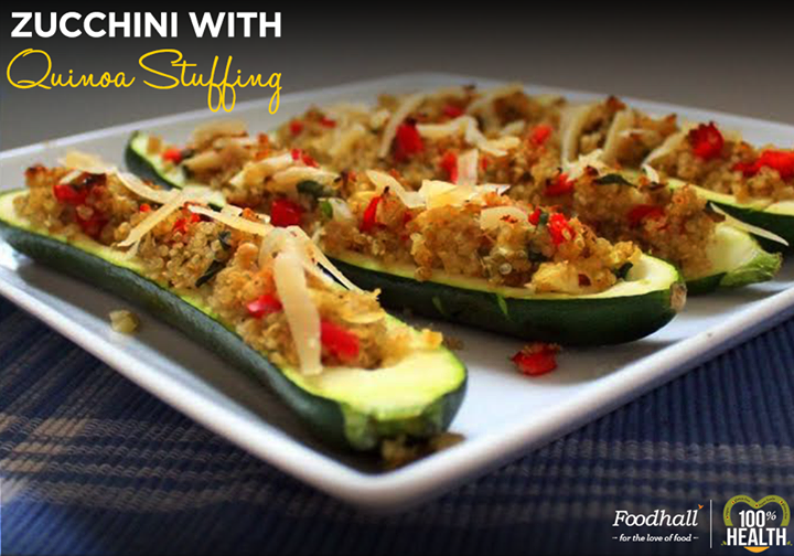 Zucchini with quinoa stuffing is a healthier and flavorful alternative to  using traditional breadcrumbs. Use it as a delicious side dish to satisfy tour taste buds.  Make your own Zucchini With Quinoa Stuffing by following this simple DIY: cut the zucchini in half lengthwise and scoop out its seeds. Mix cooked quinoa, beans, tomatoes, almonds, garlic, Parmesan, and oil. Stuff the mixture into  scooped zucchini and bake until golden.  Enjoy the wholesome zucchini stuffed with Quinoa!