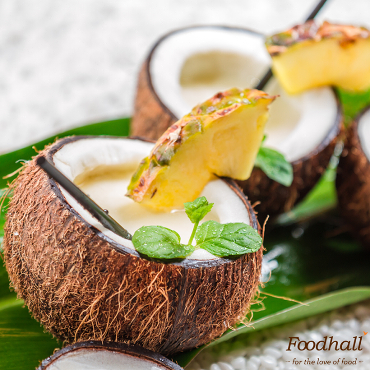 How about adding a touch of Thai flavour to the evergreen Pina Colada? Here's how we would do it:  - Pour coconut milk, pineapple juice, rum and sugar into a blender container - Blend on high speed until smooth - Add ice and blend until it is slushy!