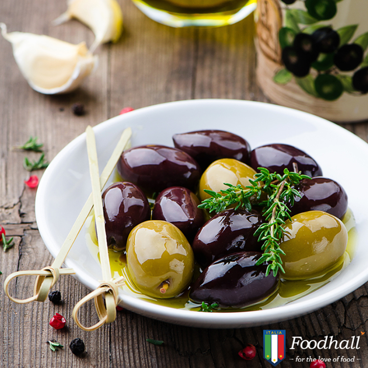 Bring in a twist to your party by serving martini marinated olives with some bread !Combine olives, gin, olive oil, dry vermouth, lemon peels, a bay leaf and heat until liquid is reduced.
