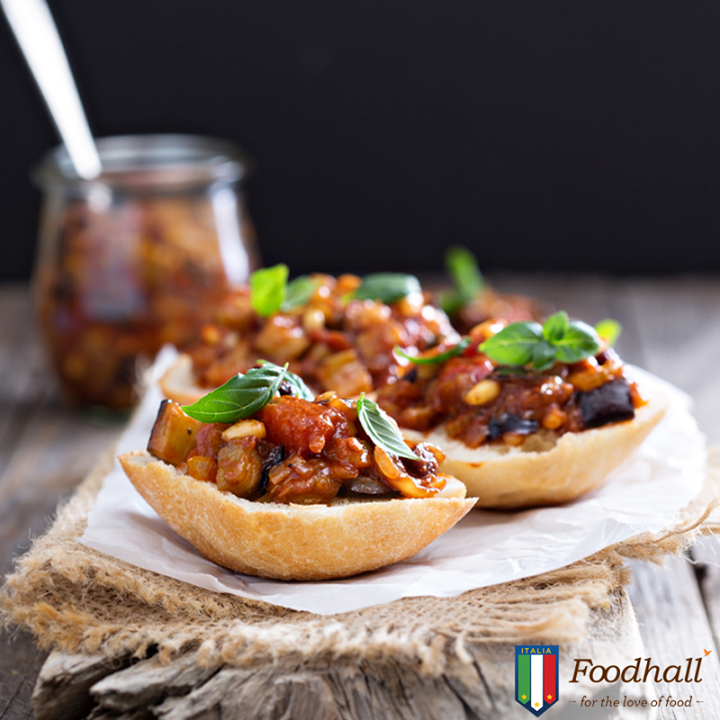 Add a twist to your crostini by spreading it with smoked aubergine caponata, Asiago cheese and fresh basil leaves. It's a platter that has the potential to become a meal-time favourite!
