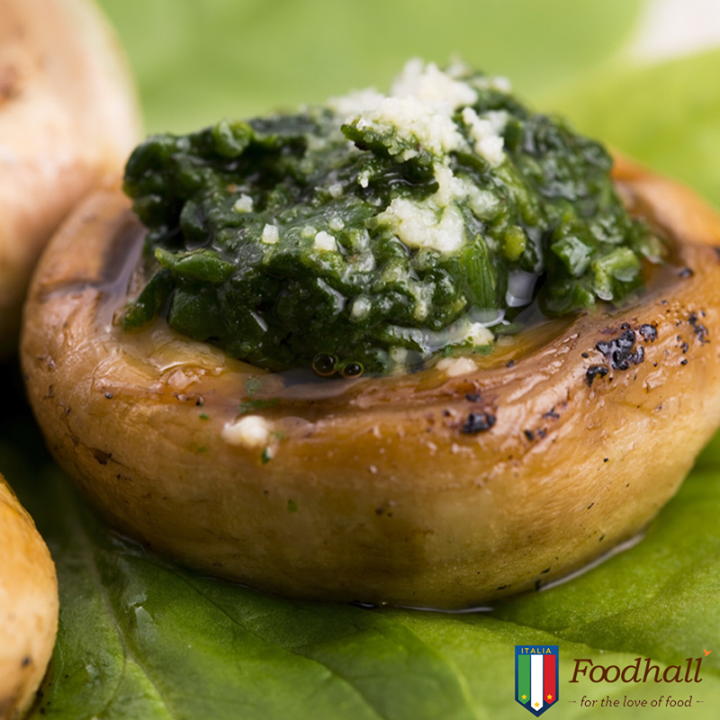 Baked mushrooms stuffed with pesto and cheese is a flavourful and quick Italian recipe that makes a delicious little appetizer for your next get together.
