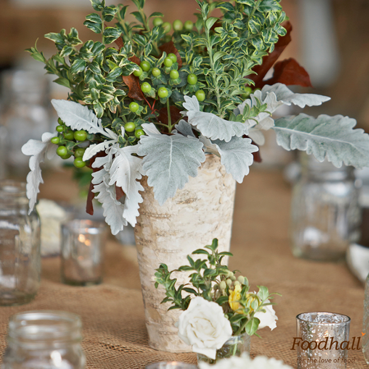 Wondering what your next party theme should be? Set up a classic yet rustic party with mason jar sippers for drinks, wooden trays for food and pastel flowers for the decor.