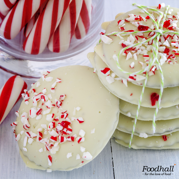 Add a touch of Christmas to your butter cookies! Generously sprinkle white chocolate and candy cane after baking.  These pretty & minty holiday cookies will make the perfect festive addition to your menu!