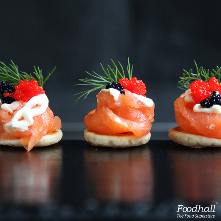 Layer a slice of smoked salmon, a wedge of stilton, some dill and caviar on crackers for some simple and delicious canapés!  These will be rejoiced by your friends and family over this party season.