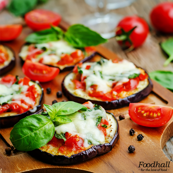 The rich and creamy combination of mozzarella, cream cheese, and cheddar, tomatoes spiced with pesto adds a zingy flavour to the eggplant.   The melting cheese garnished with basil makes it the perfect cheesy indulgence for weeknight dinner.