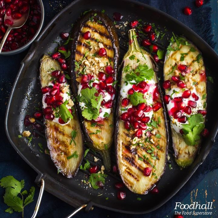 Bring out the barbecue just before summer ends. Char grilled eggplant stacked with feta, zaátar, sprinkled pomegranate seeds and parsley garnish make for an elegant finish.