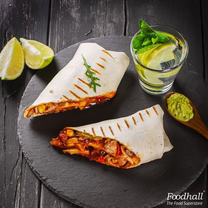 Who's in for a quick lunch?  Toss lettuce, corn, chicken, red bell peppers in barbecue sauce and wrap in a tortilla. Serve this burrito with guacamole and chilled lemonade.