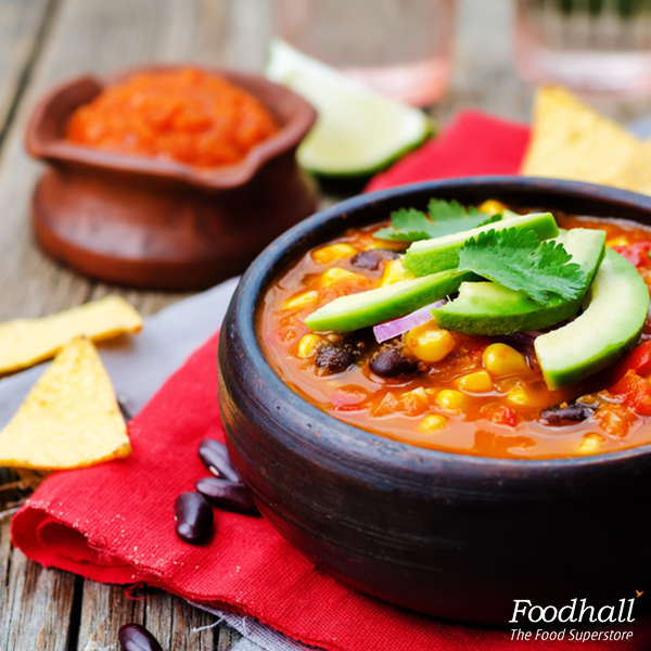 The Chipotle red bean corn tortilla soup makes for a perfect light meal on a weekday.  Simmer down 4 cups vegetable broth,  ½ chopped onion, 3 garlic cloves, ½ orange bell pepper, 4 cups red beans, 1 cup chipotle salsa, 2 cups corn kernels, 1 ½ teaspoon cumin powder, 1 teaspoon chilli powder and 2 tablespoon canola oil. Add a pinch of kosher salt and pepper for extra flavours. Serve this bowl of Mexican delight with tortilla.