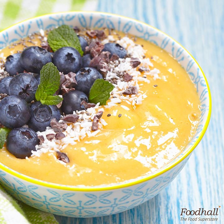 Here's some sunshine in a bowl!  Blend 1 ½ cup mangoes, ½ cup pineapples, ½ banana, 1 cup coconut water. Pour the mixture in a bowl and top it all up with mango slices, fresh blueberries, chocolate shavings and coconut flakes.