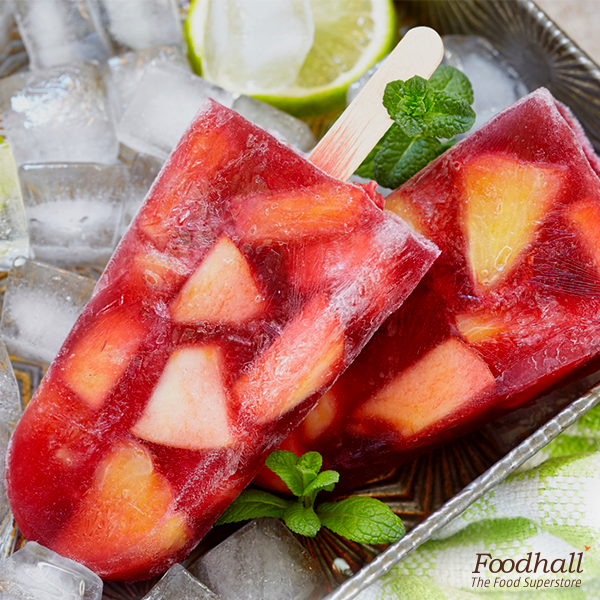 A two-in-one surprise with the sangria popsicles for your summer parties! Soak 1 cup chopped fruits in ¾ cup red wine for 15 minutes. Simmer down ¾ cup orange juice, ¼ cup lemon juice, 3 tbsp sugar; add this to the wine-fruit mixture, pour it into popsicle mould and freeze for a few hours.