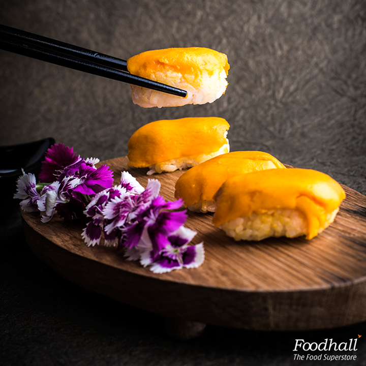 Here's a fun twist to a classic mango sticky rice: Cook sticky rice with coconut milk and sugar. Shape them into small rice balls and top with sliced mangoes. With a side of sweetened coconut milk, this is a great bite-sized dessert to serve after a spicy Thai meal.