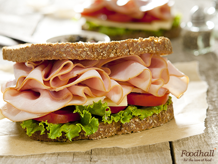 Enjoy a quick snack by putting together Italian mortadella, lettuce, tomatoes & cheese to make a delicious sandwich.