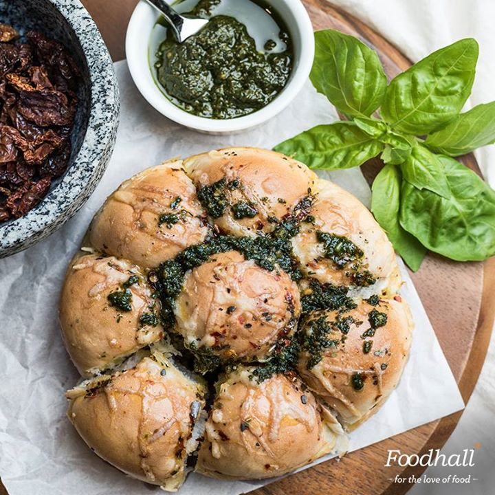 Our Italian pull-apart bread is a fun snack for your next house party or get-together. We have added a burst of flavours to smooth buttery bread rolls with sundried tomato, olives, rosemary and parmesan. Top it off with our special basil pesto and you have a winner!