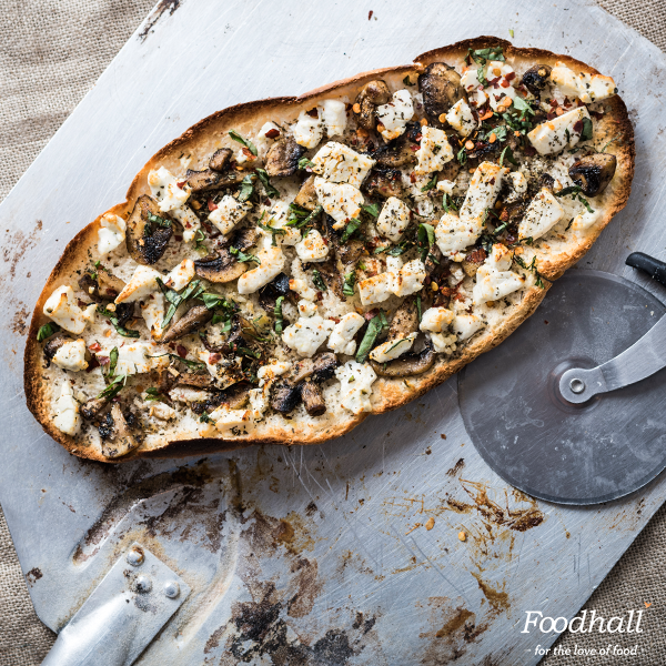 Bite into delicious flatbreads with goat #cheese & mushrooms & moreish spices – so tasty that it'll have you rushing for seconds. Visit our store to get your hands on it fresh from the oven!