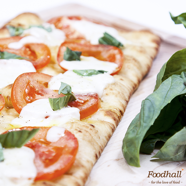 Hands up if you'd love a fresh flatbread for lunch! 🙌  We've made ours with our new cracker-thin flatbread, juicy 🍅, 🧀 and fragrant basil leaves 🍃 . . How would like yours? Tell us in the comments below!