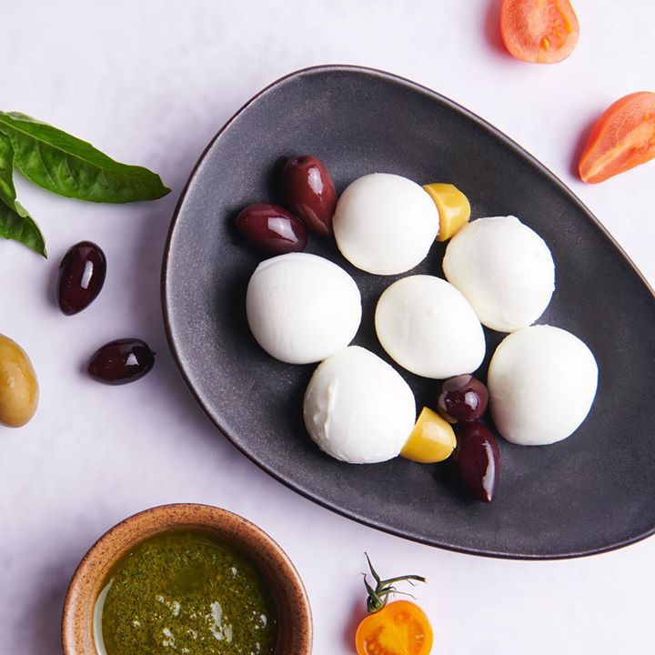 Freshly made bocconcini is best eaten with basil pesto. Serve it during summers as an indulgentappetiser. Get all the ingredients from the nearest Foodhall store.