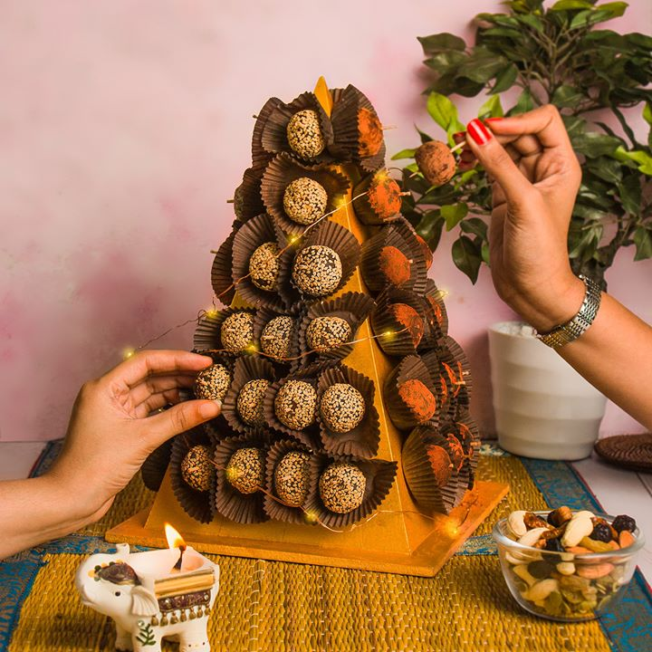 Elevate your festive table this #Diwali, with a tempting tower of our date balls from #Bustaan. Made with the most succulent Iranian and Saudi Arabian dates, it's a fabulous centrepiece at your next festive soirée!  #ForTheLoveofDates #FoodhallIndia #Diwali #FestiveSeason #DiwaliParty #FestiveGifting #DateBalls #Dates #HealthyTreats #HealthyDesserts #DiwaliDesserts
