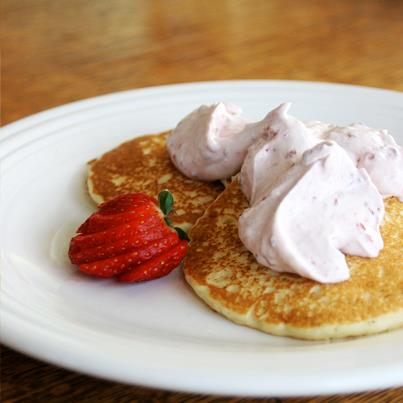 Few foods say 'Good Morning' as well as a stack of pancakes with dollops of whipped cream, no?