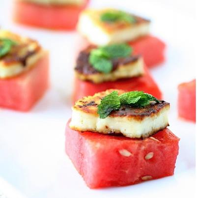 Halloumi cheese, made of goat and sheep's milk, is semi-soft in texture and has a salty flavor. It can be grilled and served atop squares of watermelons. A splash of texture+flavor in the mouth, yes?!