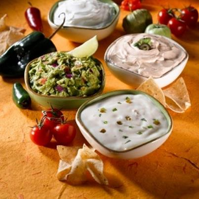 Dips are all an essential staple of Mexican food. Be it cilantro salsa dip, chili cheese dip, spicy nacho dip - serve one or multiple dips with wafers or tortilla chips and please your guests with this amazing entree.