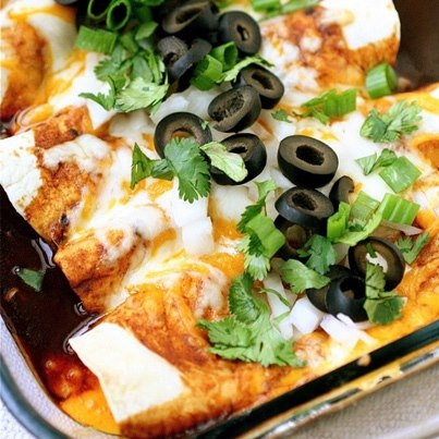 Enchilada is a delicious and hunger-satisfying Mexican roll. Vegetables, cheese, beans and/or potatoes are filled in a tortilla and served with a sprinkling of cheese and jalapenos. YUM!