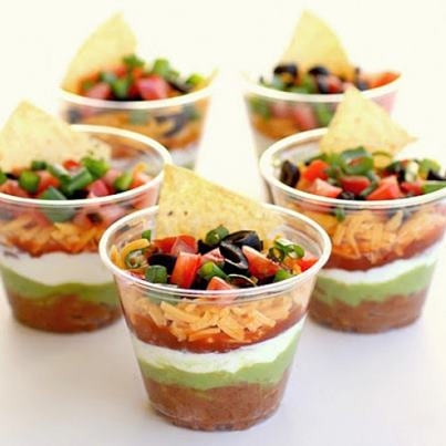 Recipe - Dip & Chips: 1 can black beans, 1 chopped onion, 2 cloves garlic (minced), 1 tbsp chipotle, 4 tbsp lime juice, 2 cups corn kernels, 1/4 cup cilantro, 2 ripe avocados (mashed), 4 tomatoes (mashed), 1 tbsp jalapeno, 1 cup cheddar cheese, 1 cup black olives. Mix all and serve with Tortillas.