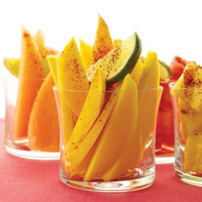 Mangoes go Mexican! Sprinkle ground chilies, squeeze fresh lime juice and add some salt to mango slices and relish the taste.