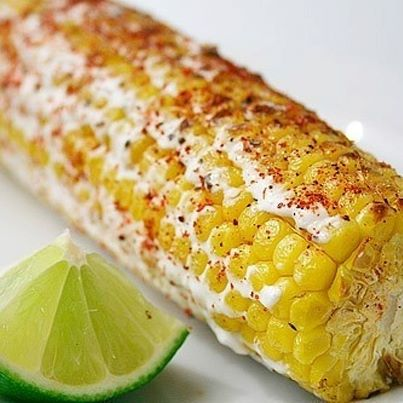Corn on the Cob smothered with Monterey Jack cheese, chilli powder and lime = Indian snack with Mexican tadka!