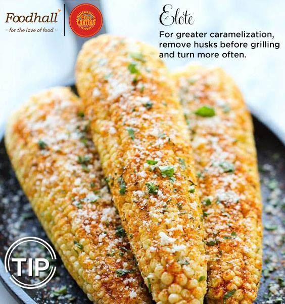 Grilled corn layered with a creamy sauce and seasoned with garlic, chilies and cilantro!   This  popular Elote makes for a light and tasty evening snack.