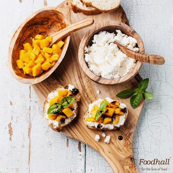 #PartyInStyle Make the most of the last batch of mangoes this season! Chop mango into small cubes. Spread goat cheese onto warm slices of the baguette, top with mango cubes, drizzle with balsamic glaze. Garnish with fresh basil and serve!  Check out more recipes for quick & easy party snacks on Instagram, follow us at: instagram.com/foodhallindia