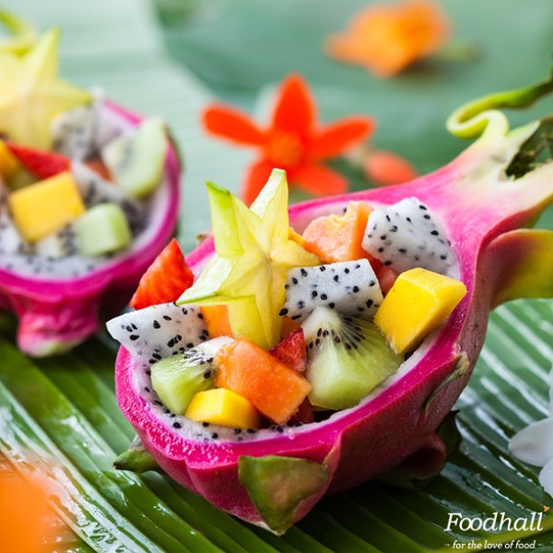 #PartyInStyle Try out this Quick DIY to add a touch of exotic to your party table! Begin by scooping out the dragon fruit using a melon baller until the skin of the fruit is hollow. Layer your favorite tropical fruits into the dragon fruit skin and garnish with mint. Place in the fridge for 20 minutes to chill and serve! #FoodhallIndia #FoodhallFavourites #DIY