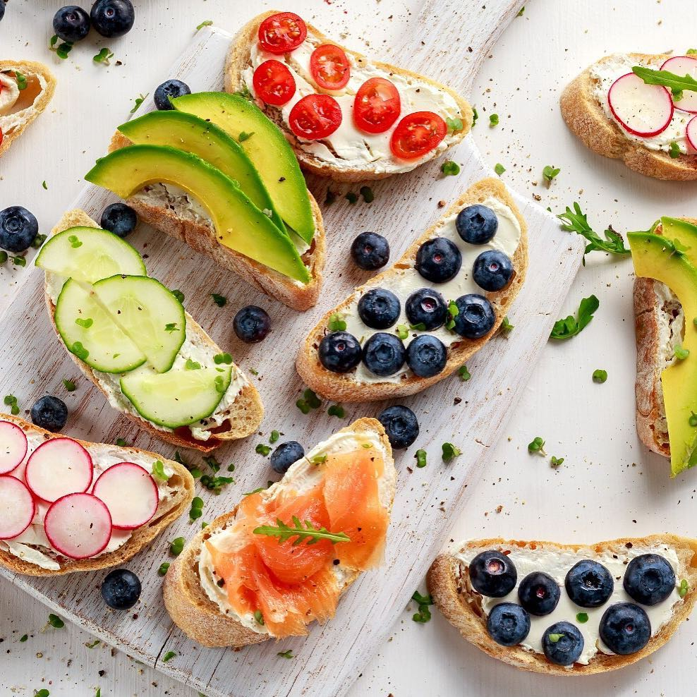 Inspired by summertime, we are feeling adventurous with gorgeous open-faced sandwiches brimming with goodness. Mix and Match herb bread, sour dough or your favourite multigrain bread with hummus, cream cheese or guacamole. Top it off with blueberry or crunchy slices of pink radish. Grab a fork and knife, this one will leave you coming back for seconds.