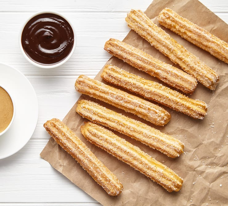 Churros, a golden brown Mexican street snack. Dip it in dark chocolate with a hint of cayenne pepper and enjoy it for breakfast, after-dinner or munch at any time of the day. Recipe link in the bio.