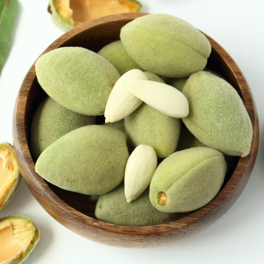 "#FoodhallLoves: Green Almonds! If you've never had these, it's about time you discovered green almonds at a Foodhall near you.  Fuzzy on the outside, these seasonal #stonefruits are filled with soft, jelly-like ""young"" almonds.  When fresh, you can (and should) eat green almonds whole to enjoy their tart and crunchy flavour, enriched with a touch of sea salt. Or if you prefer the more delicate, floral taste of young almonds, you can chop these into your next salad or whip up a pesto sauce by blitzing with herbs and green garlic! They work just as well sprinkled on desserts such as tarts and ice cream too.  #FoodhallIndia #ForTheLoveOfFood #GreenAlmonds"