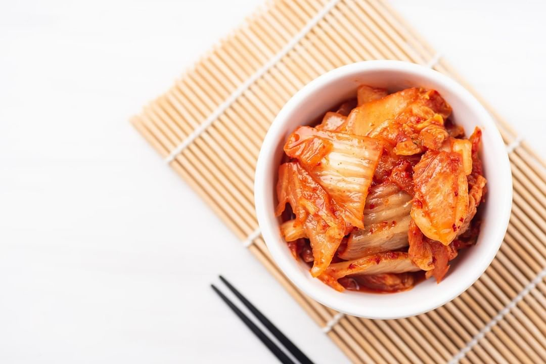 #FoodhallLoves: Korean Kimchi!  A staple in Korean cuisine, #kimchi is made by fermenting cabbage, Korean radish and other veggies with spicy seasonings. Packed with millions of lactobacilli, it's great for your gut health!  You can nibble on it as is (kimchi tastes great on it's own!) or add it to rice, grain bowls, noodles and even eggs! Visit a #Foodhall near you for your fix of this fermented superfood and look out for our #recipe cards on how to cook with kimchi at home!  #FoodhallIndia #KoreanCuisine #KoreanCooking #FermentedFoods #RecipeShare #HealthyLiving #GutHealth