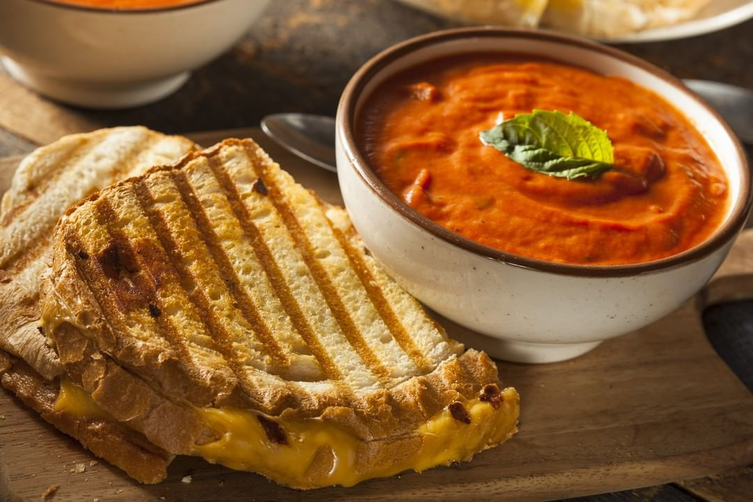 This December, if you find yourself winter-wishing for a bowl of comfort, why not pop by The Cafe by Foodhall for a satiating sip of our Charred Tomato and Cheese soup?  Pair your craving with our elevated lift to the humble grilled cheese sandwich – a Gruyere and Mushroom special. Crafted with gourmet grilled cheeses such as sweet-yet-salty cuts of true Swiss Gruyere and the mild-but-savory Emmentaler, this winter-warmer is stuffed with lightly flavored mushrooms, seasoned in rosemary and garlic butter!  #ForTheLoveofComfortFood, tuck into our winter specials at The Cafe by Foodhall, at a Foodhall near you!  #WinterSpecial #ForTheLoveofCheese #FoodhallIndia #SoupsAndSandwiches #TheCafebyFoodhall #CravableComforts #ComfortFood #Cravable #GourmetGrilledCheeses #WinterWarmers #SatiatingSoups